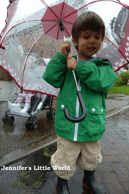 Child under umbrella in the rain