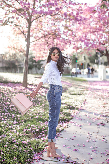high-rise jeans with suede pumps and a blush satchel