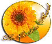 "A picture of a sunflower with a yellow backdrop and the words ""The Sunshine Award"" in gold script."