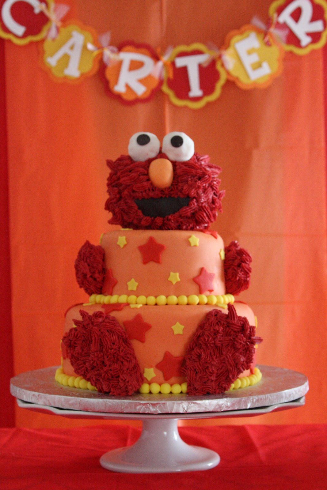 Two Tiers Of Cake With A Rice Cereal Elmo Is Covered Buttercream Took 2 1 Jars Food Dye To Get Him Red Customer Nicolette Was Kind