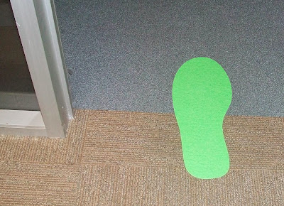 printed contour cut green footprint used for directional signage