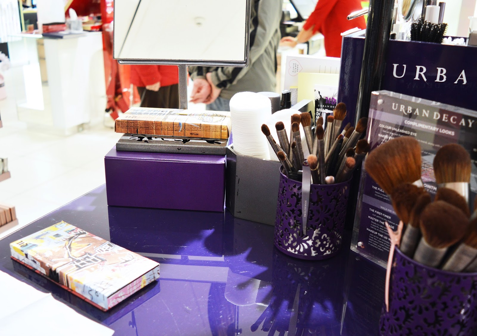 Urban Decay counter with brushes and make-up on