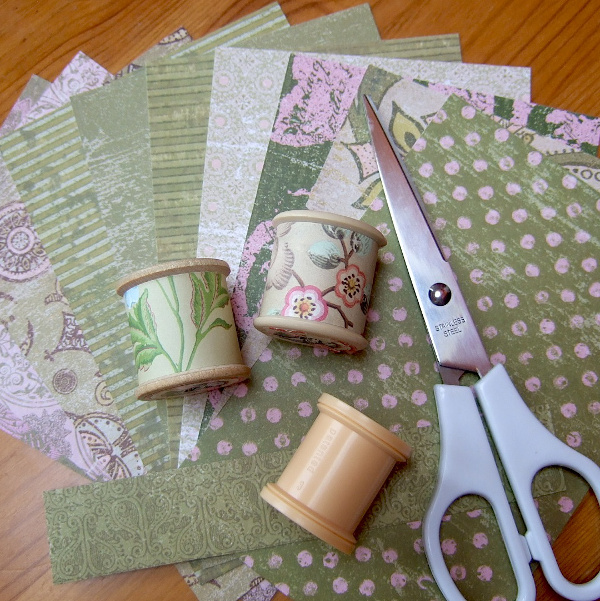 Covering plain plastic thread spools with patterned scrapbook papers