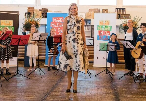 Queen Maxima's print dress is by Belgian fashion house Natan, Prada earrings. LK Bennett sledge patent leather platform heel pumps