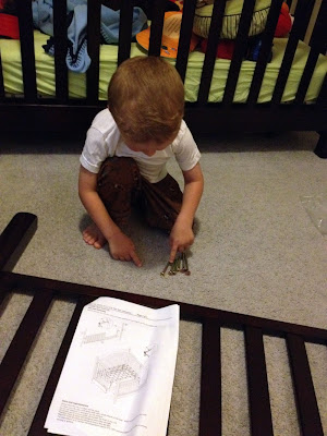 toddler helping build bed