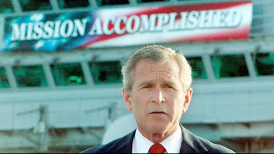 George W Bush Mission Accomplished speech. Competition of Incompetence and Other stories of Military Intelligence marchmatron.com