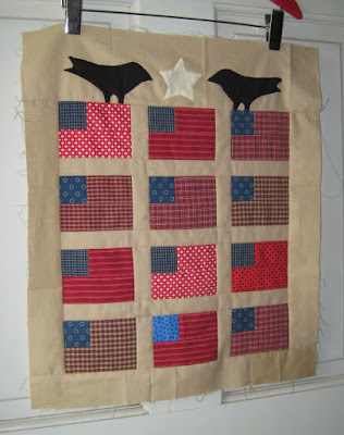 small flag quilt top with applique from a pattern by Cheri Payne