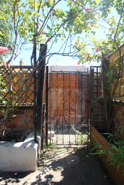 old metal gate in victorian garden
