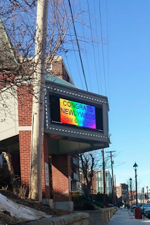 rainbow sign at Capitol Center for the Arts