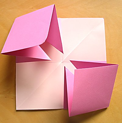Press Down On The Whole Lot And You Should Have A Square Book Put Something Top Of It To Stop All Springing Out Again