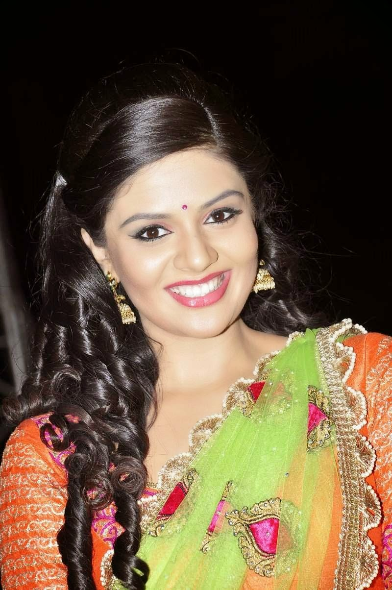 Sree mukhi Stills In Orange Half Saree