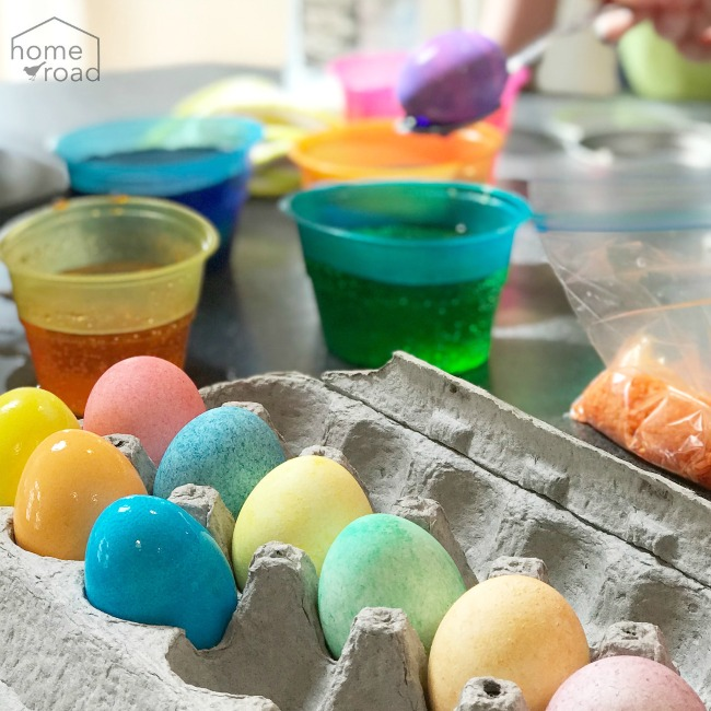 Colored eggs and cups of dye