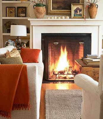 Cozy fireplace and pumpkin hued accents in beautiful room - Fall decor inspiration