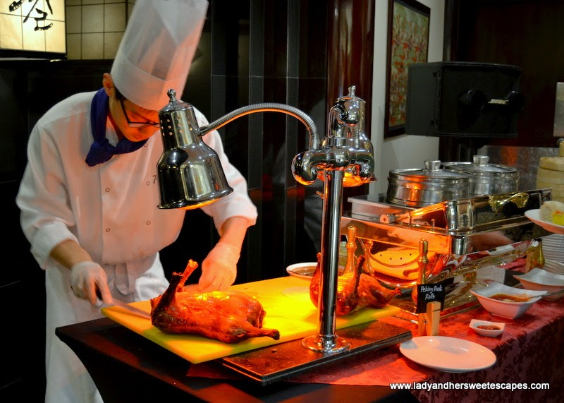 Peking Duck carving station at Minato Radisson Blu