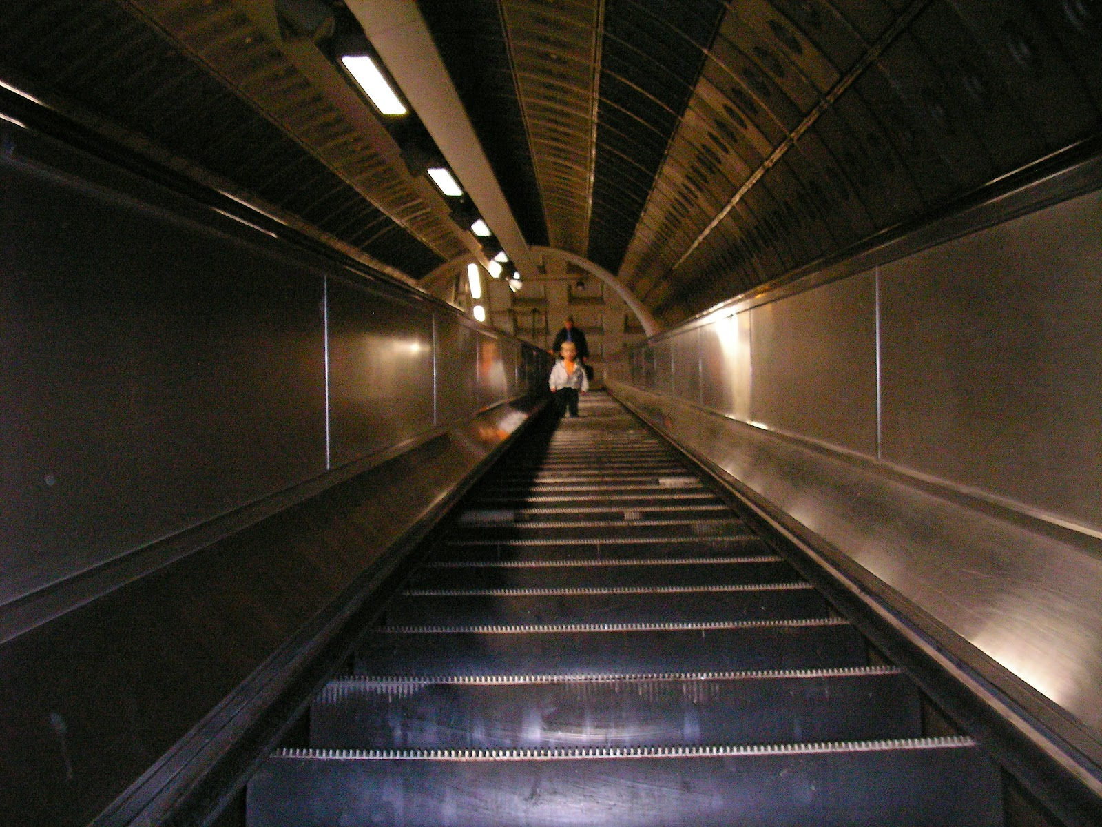 london underground tube line escalator
