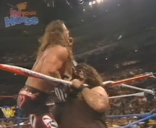 WWF / WWE IN YOUR HOUSE 10: Mind Games - Mankind locks the mandible claw on Shawn Michaels in the WWF title match