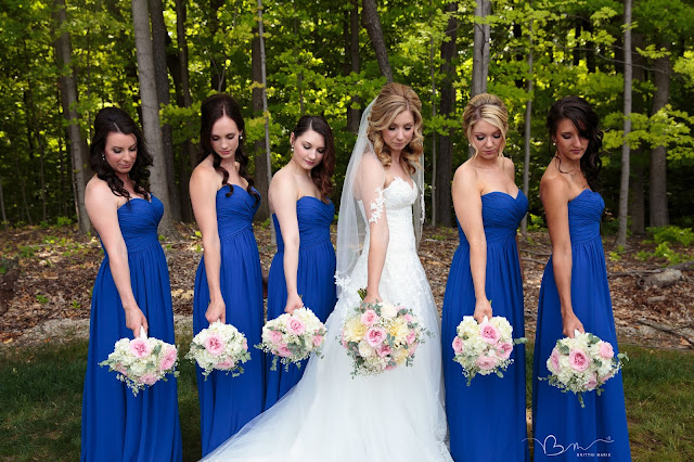 bridesmaids with flowers at Noah's Event Venue in Auburn Hills Michigan