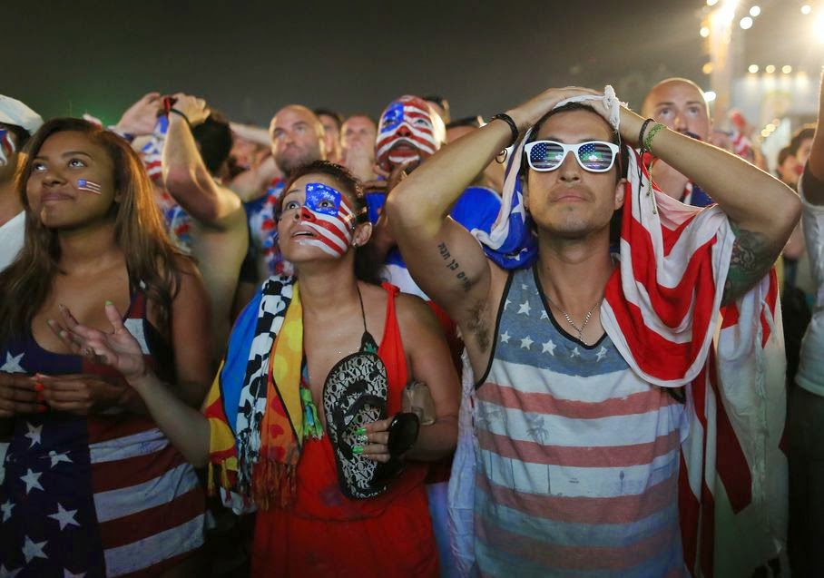 Fans of the United States national soccer team react, in frustration, as they watch their team's World Cup round of 16 match against Belgium on a live telecast inside the FIFA Fan Fest area on Copacabana beach in Rio de Janeiro, Brazil, Tuesday, July 1, 2014. Belgium beat the United States 2-1 in extra time to reach World Cup quarterfinals.