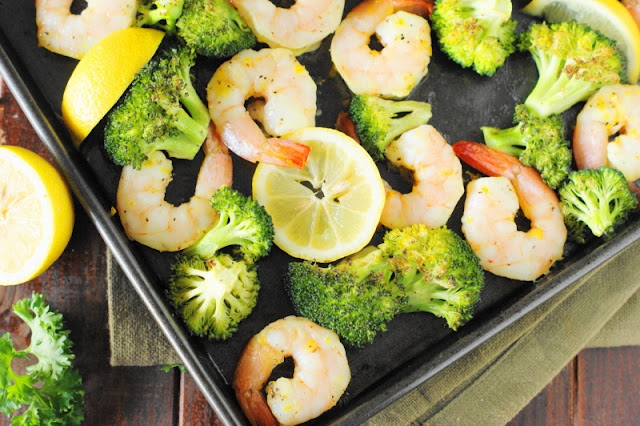 Roasted Shrimp & Broccoli Sheet Pan Supper ~ With just a little tossing of ingredients together, this one-pan dish with tasty lemony shrimp and cumin-spiced roasted broccoli is ready in under 30 minutes.   www.thekitchenismyplayground.com
