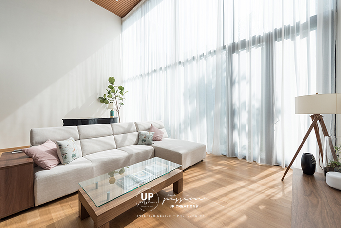 ss1 bungalow double volume living area with full sheer curtain, solid wood maple flooring, white fabric L shape sofa and wood coffee table