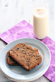 Slices of fresh baked Gluten-Free Banana Nut Bread with a glass of milk.