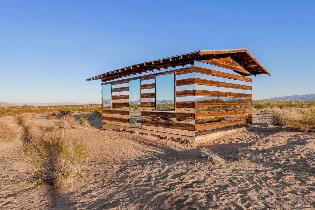 This remote shack in the middle of the desert has been transformed by artist Phillip K Smith III. - This Is What Happens When You Put Rows of Mirrors on a Shack in the Desert
