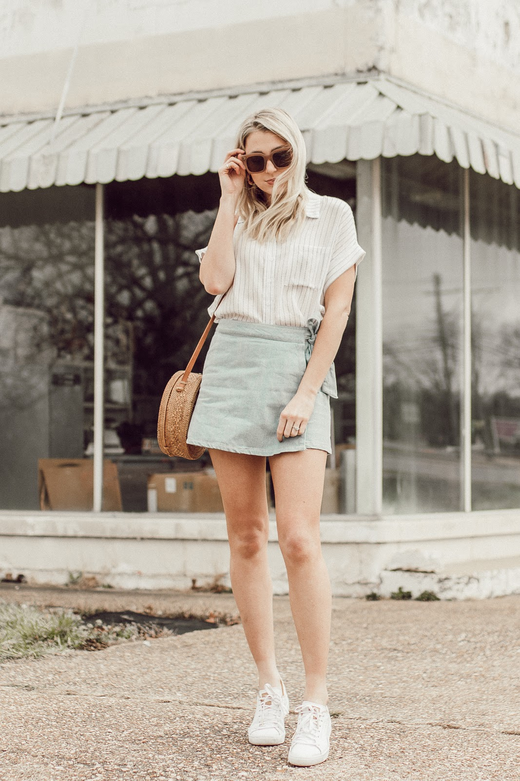 Short sleeve button down blouse with a denim skirt