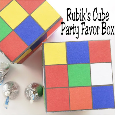 Have a little fun at your 80s party with these fun printable Rubik's Cube party favor boxes.  Print out these treats for your dessert table or party bags and fill with yummy party treats for the perfect gift for your guests. #rubikscube #80sparty #partyfavor #diypartymomblog