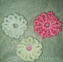 http://crocheteandoconimaginacion.blogspot.com.es/2014/03/flor-crochet-facil.html