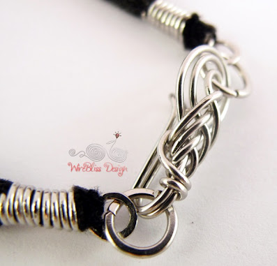 Close up of wire wrapped pipa hook/clasp on leather
