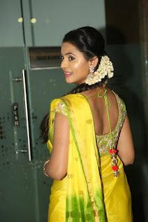 Actress Manasa Stills in Yellow Saree at Savitri Audio Launch  0044