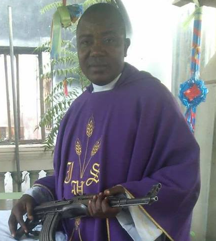 catholic priest carries gun inside church