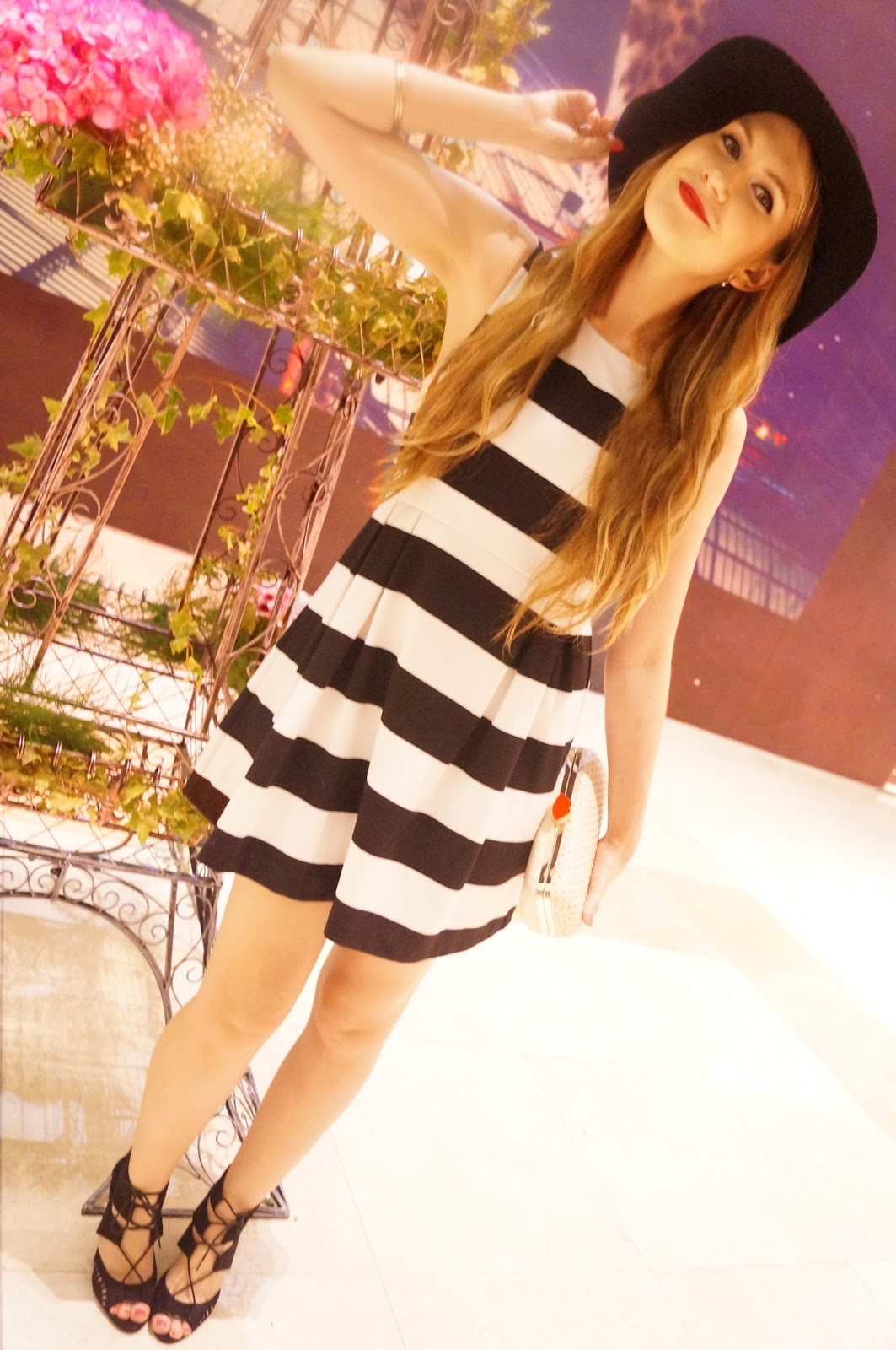 Pair a Black and White dress with a black floppy hat to look Parisian Chic!
