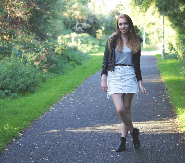 white skirt and black leather jacket
