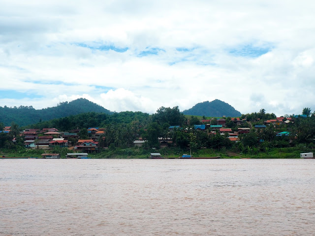 Village houses on the bank of the Mekong river in Laos