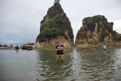menyeberang ke karang