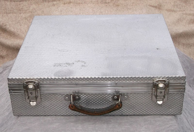 Image of a small solid aluminium flight case from above
