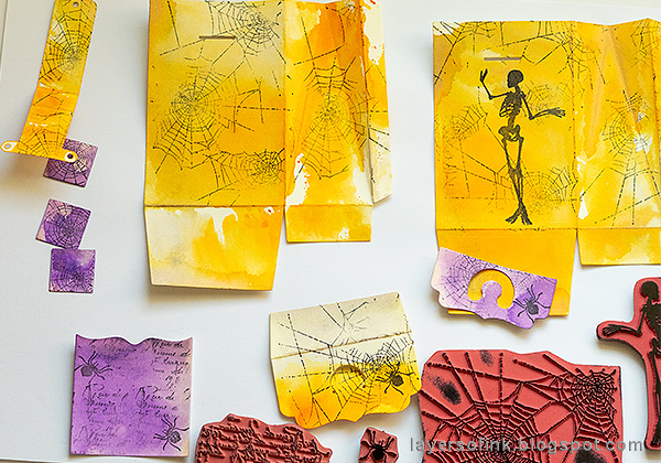 Layers of ink - Waterfall Video Tutorial by Anna-Karin Evaldsson, stamping papers with Halloween stamps.