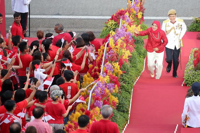 Madam Halimah Yacob arriving at her first NDP as president.