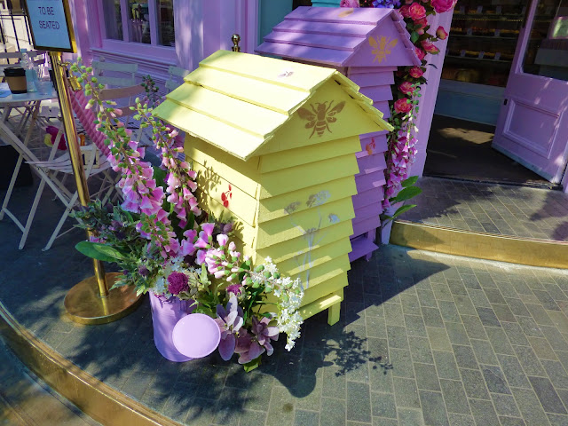 Floral display outside Peggy Porschen cafe in London, for free flower festival Belgravia in Bloom 2018
