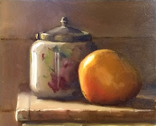 Oil painting of an Art Deco biscuit barrel beside a mango.