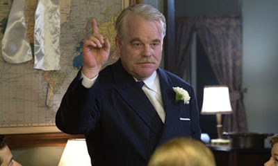 Philip Seymour Hoffman as Lancaster Dodd in The Master, delivering a speech, directed by Paul Thomas Anderson