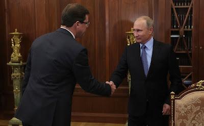 Vladimir Putin and Dmitry Azarov meeting in the Kremlin.