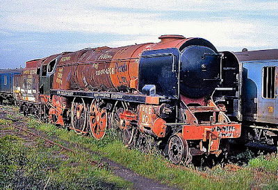 Former Southern Railway steam locomotive 35006 seen slowly rusting away in Dai Woodham's scrapyard in Wales.  Fortunately it was eventually rescued and restored and is now doing what it was built to do