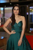 Raashi Khanna in Dark Green Sleeveless Strapless Deep neck Gown at 64th Jio Filmfare Awards South ~  Exclusive 088.JPG