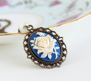 https://www.etsy.com/listing/152987339/cameo-necklace-purple-and-ivory-flower?ref=shop_home_active_2