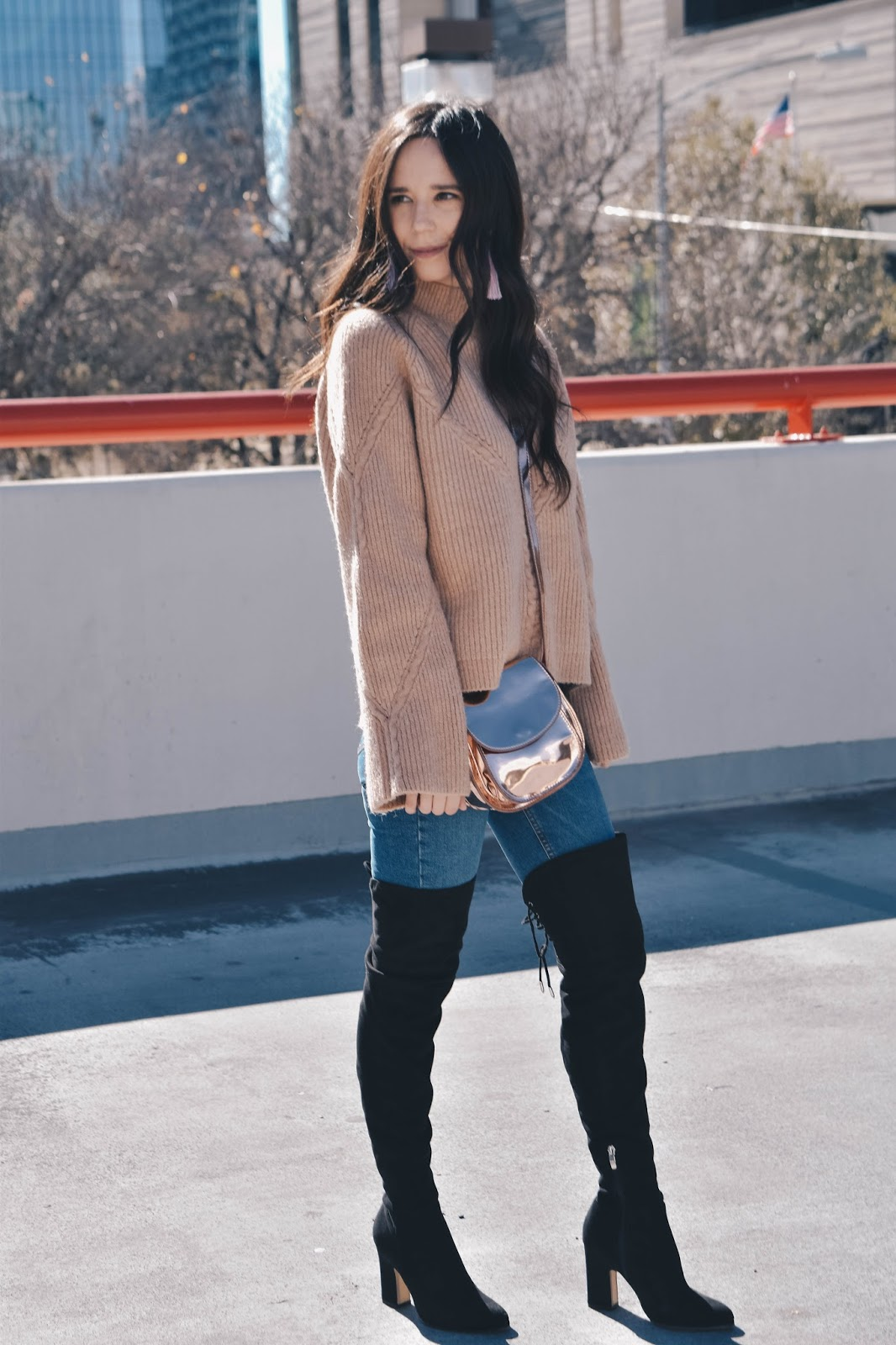 Sweater and knee high boots