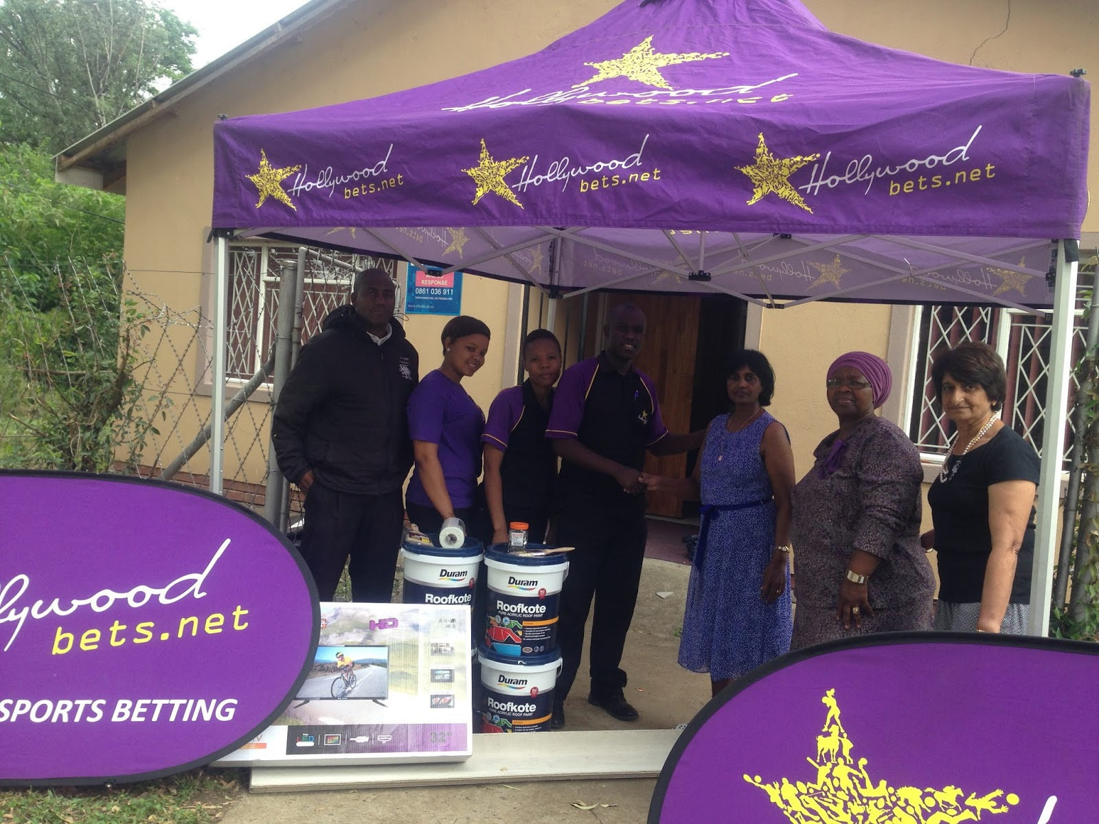 Staff at Eldorado Home for Disabled Persons are thankful for a donation of paint and a TV from Hollywoodbets