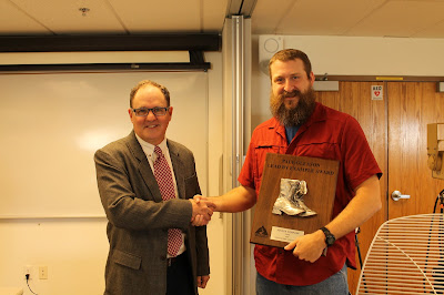 Dr. Carl Seilstad presenting Justin Vernon his award