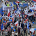 Poles march in thousands against government policies